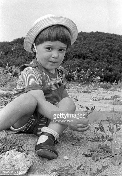 Baby boy sitting on beach