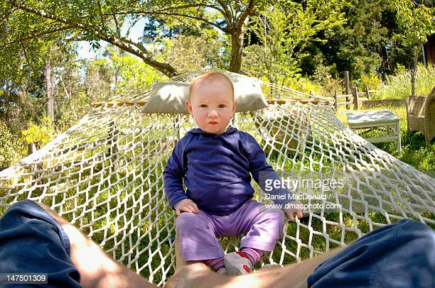 Baby boy sitting on hammock