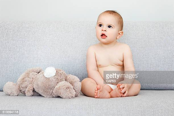 Baby Boy Sitting With His Rabbit