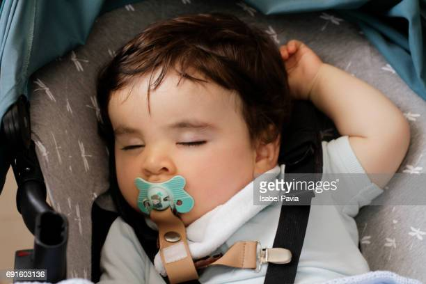 Baby boy (11 months) sleeping in car seat