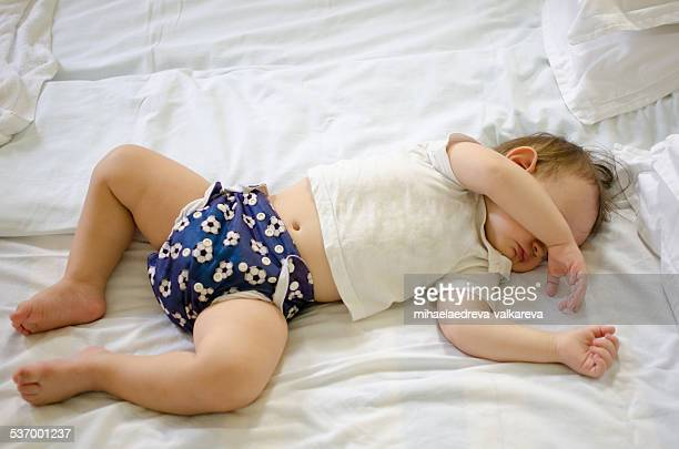 baby boy sleeping on a bed - legs apart stock pictures, royalty-free photos & images