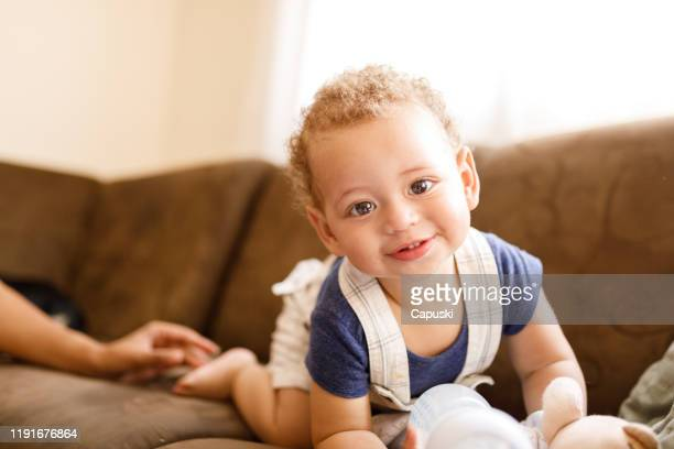 baby boy smiling at the camera - baby boys stock pictures, royalty-free photos & images