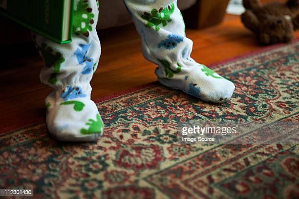 Baby boy standing on rug