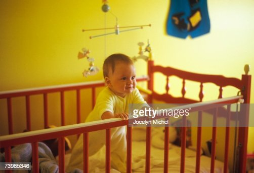 Baby Boy Standing Up In His Crib Stock Photo Getty Images