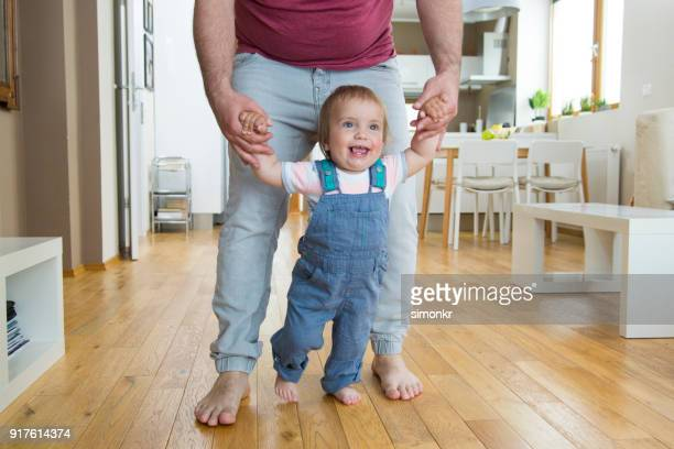Baby boy taking first steps