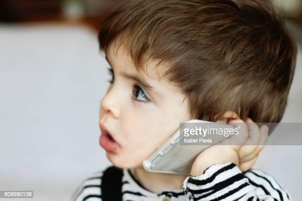 Baby boy talking on smart phone