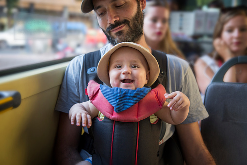 Baby boy travelling on the bus with dad - gettyimageskorea