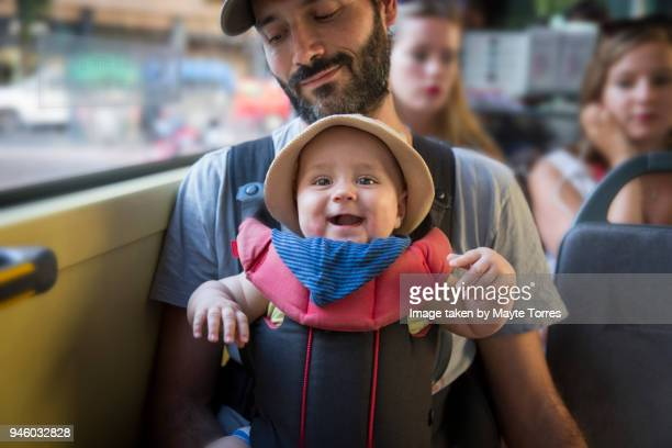 Baby boy travelling on the bus with dad