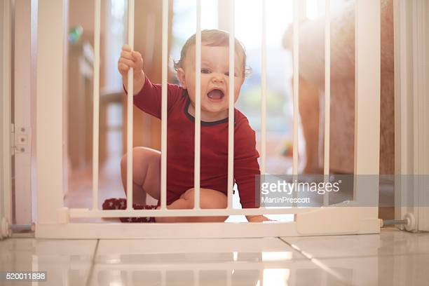 Baby boy upset at the baby gate