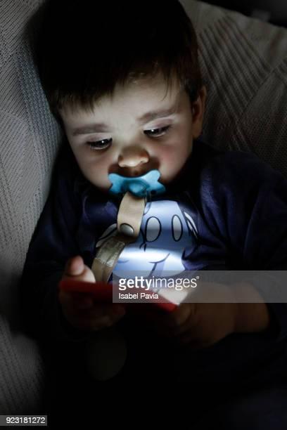 Baby boy using digital tablet