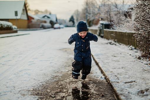 Baby boy walking on street in winter - gettyimageskorea