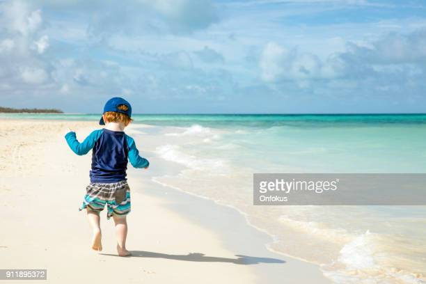 Baby Boy Walking on Tropical Beach, Cayo Coco, Cuba