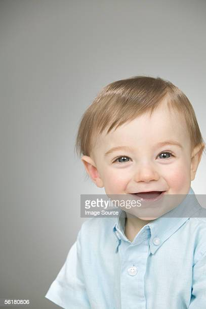 baby boy wearing a blue shirt - one baby boy only stock pictures, royalty-free photos & images
