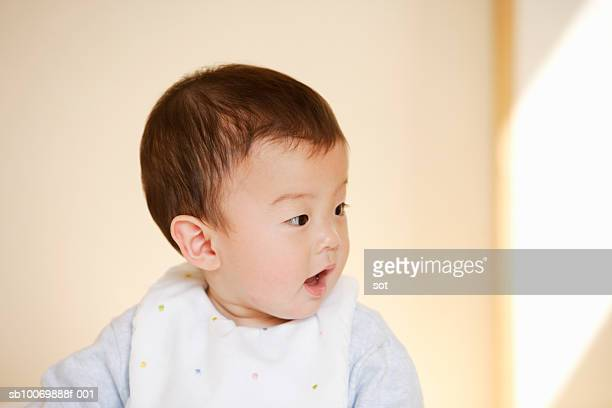 baby boy (6-11 months) wearing bib - 6 11 months stock pictures, royalty-free photos & images
