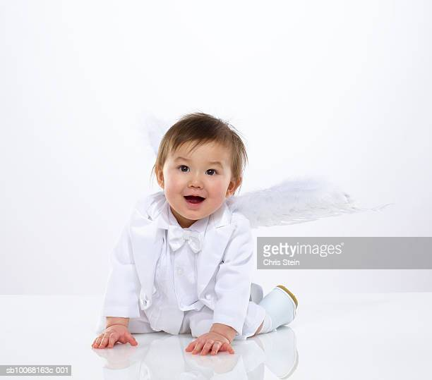 baby boy (6-11 months) with angel wings, studio portrait - 6 11 months stock pictures, royalty-free photos & images