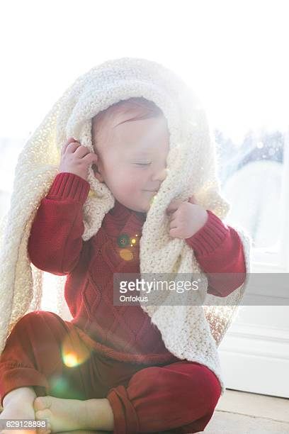 Baby Boy With Blanket at Window in Winter