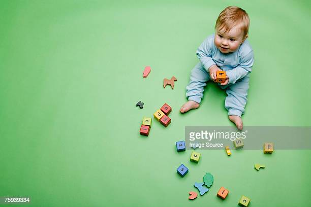 Baby boy with building blocks