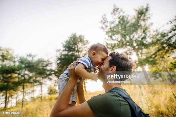 baby boy with daddy in the nature - one parent stock pictures, royalty-free photos & images