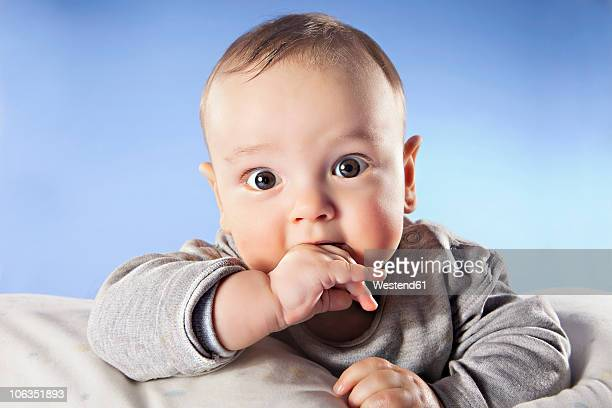 baby boy (6-11 months) with finger in mouth, close up, portrait - 6 11 months stock pictures, royalty-free photos & images