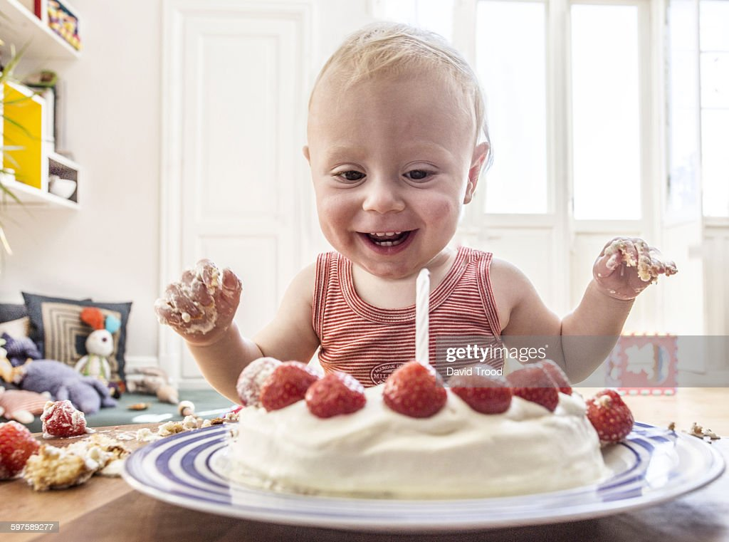 Baby boy with his first birthday cake : Stock Photo