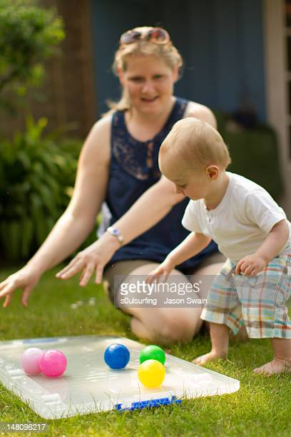 baby boy with mother - s0ulsurfing stock pictures, royalty-free photos & images