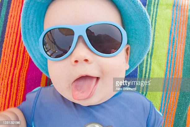 Baby boy with sun hat and sunglasses