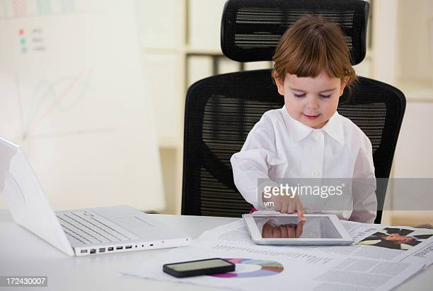 Baby businesswoman with a digital tablet