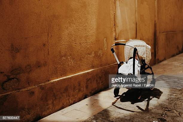 baby carriage in a street - abandoned stock photos and pictures