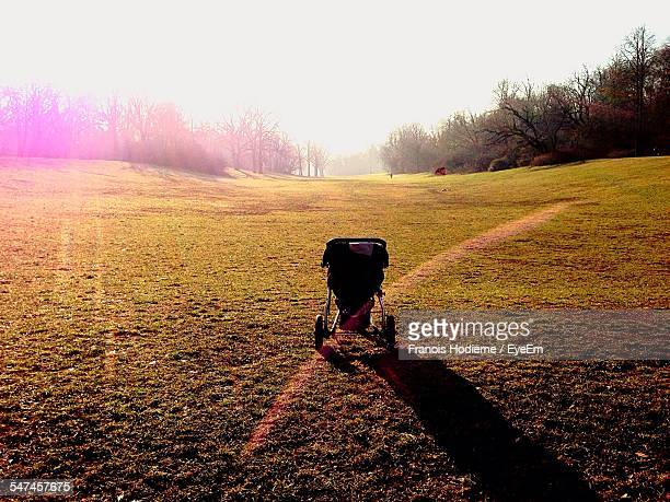 Baby Carriage On Grassy Field