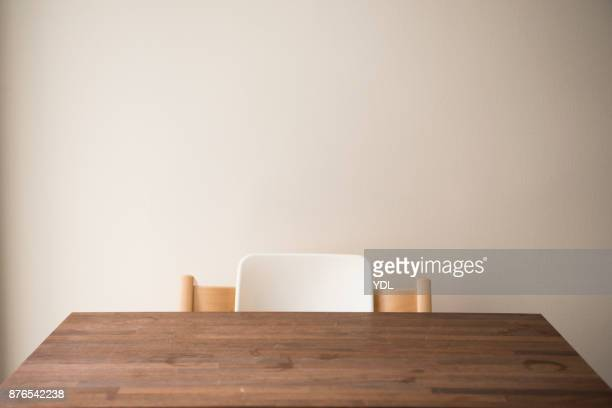 a baby chair and wooden desk. - 机 木 ストックフォトと画像
