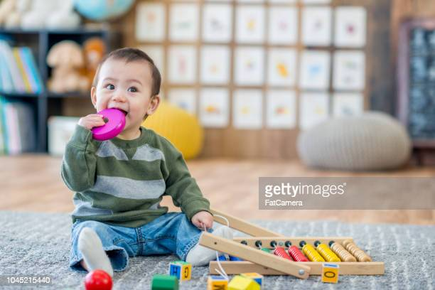 baby chewing toy - child care stock pictures, royalty-free photos & images