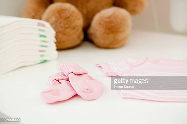 Baby clothes and bear