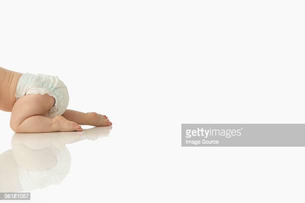 Baby crawling away