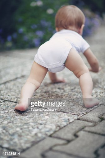 Baby Crawling With Butt Up In The Air High-Res Stock Photo ...