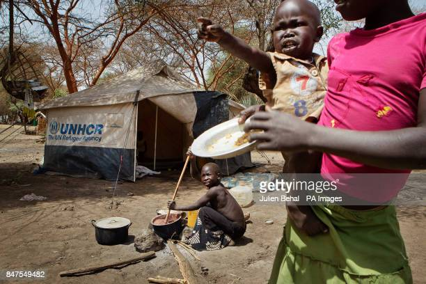 A baby cries outside her tent in Doro refugee camp in BunjMaban in the Upper Nile Blue Nile state of northeastern South Sudan AfricaThe region...