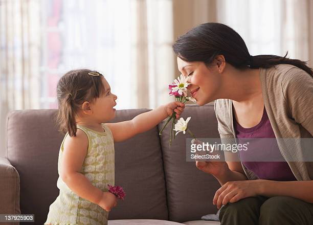 Baby daughter holding flowers  for