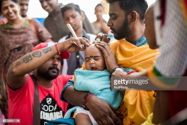 A baby devotee has her head shave before taking part in the procession to the sacred Batu Caves temple during the Thaipusam festival at Batu Caves in...