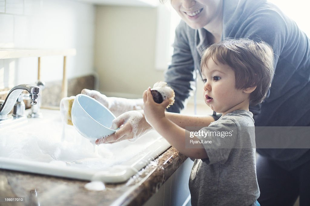 Baby Dish Washing : Stock Photo