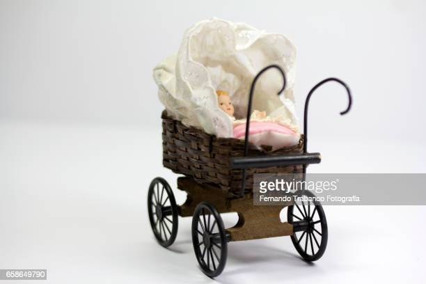 Baby Doll in Old Baby Carriage