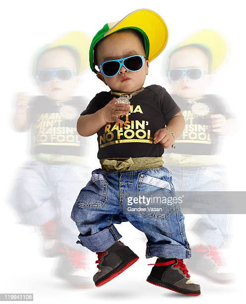 Baby dressed as urban rapper dancing