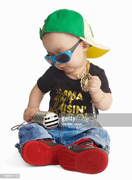 Baby dressed as urban rapper seated