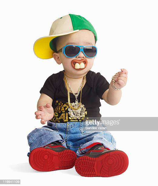 Baby dressed as urban rapper with pacifier