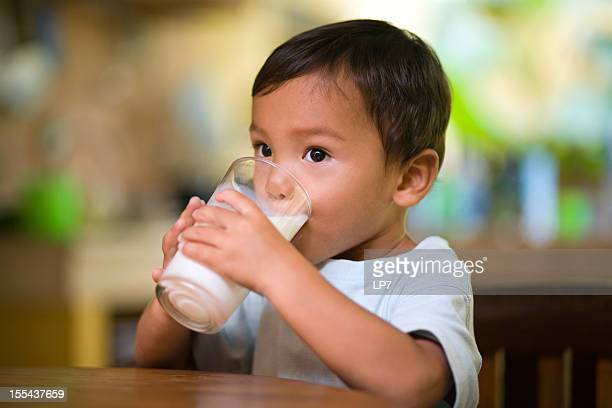 baby drinking milk - asian drink stock photos and pictures