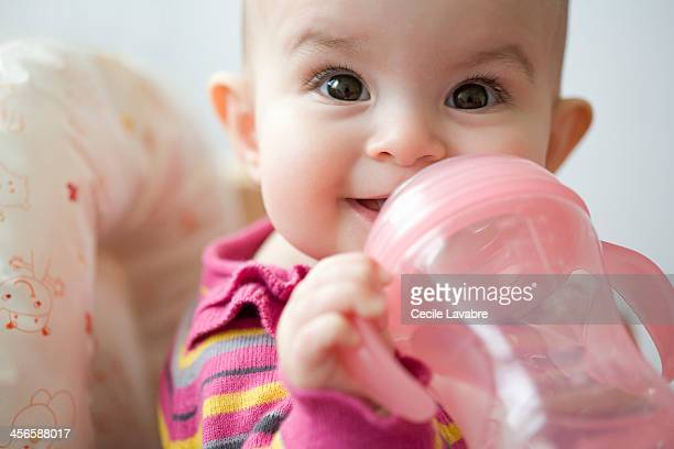 Baby drinking water from baby cup