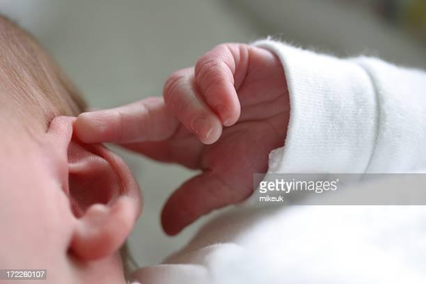 baby ear hand finger listen