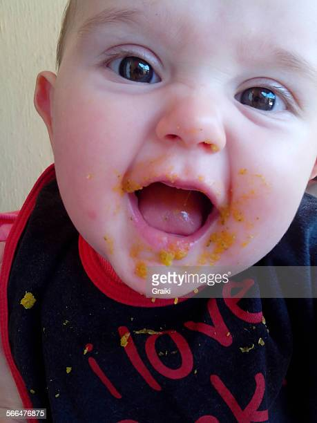 Baby eating and messing .