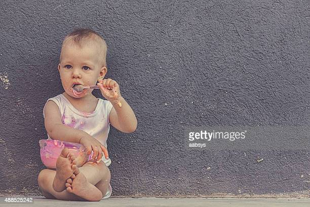 Baby eating ice cream.