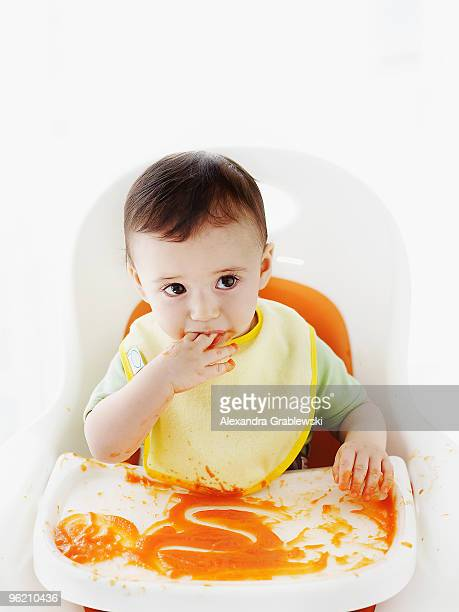 Baby Eating in Highchair