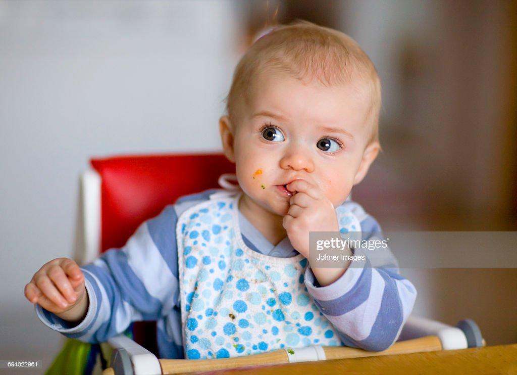 Baby eating : Stock Photo