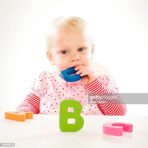 baby eating toy letters